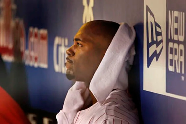 A dejected Jimmy Rollins sits in the dugout with the Phils down, 5-2, and one last at bat in the 13th inning Friday at Citizens Bank Park. (Ron Cortes / Staff Photographer)