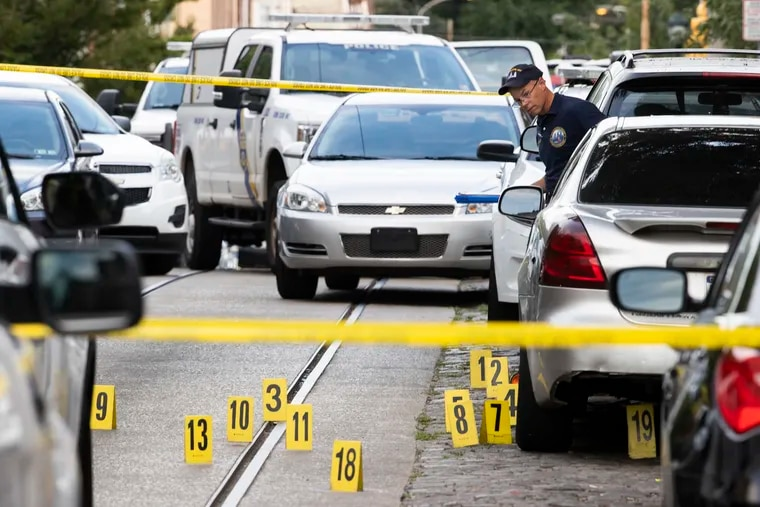 Five individuals were shot outside 5104 Germantown Ave. at approximately 5:30 PM on Aug. 19, 2021. One person was fatally shot. The Crime Scene Unit looks over the scene.