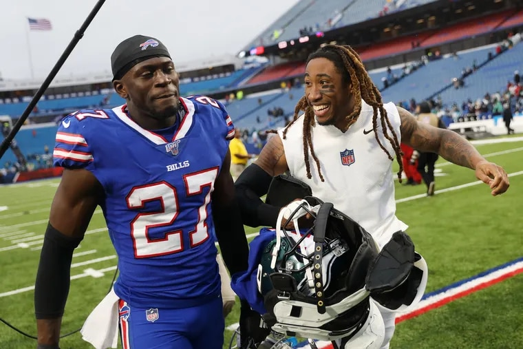 Buffalo Bills cornerback Tre'Davious White (27) talks with Eagles cornerback Ronald Darby, his teammate briefly in the spring and summer of 2017, after a game at New Era Field in Orchard Park, N.Y., on Sunday, Oct. 27, 2019. The Eagles won 31-13.