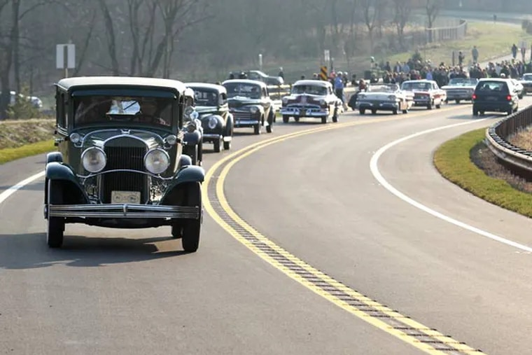 An antique car procession on Monday ceremoniously opened the Route 202 parkway. Charles Fox / Staff Photographer