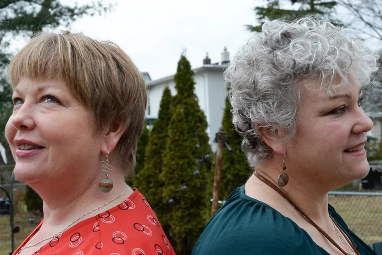 Token of Affection's Bernadette Moyer of Conshohocken (left) and Sally Ludwig of Audubon show off their earrings outside Ludwig's house.