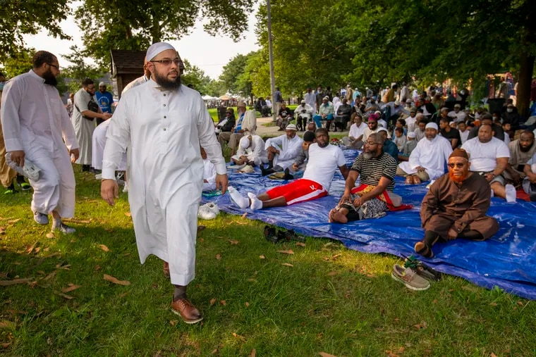 Dr. Tahir Wyatt with the United Muslim Masjid arrives to give the morning prayer at Durham Park.