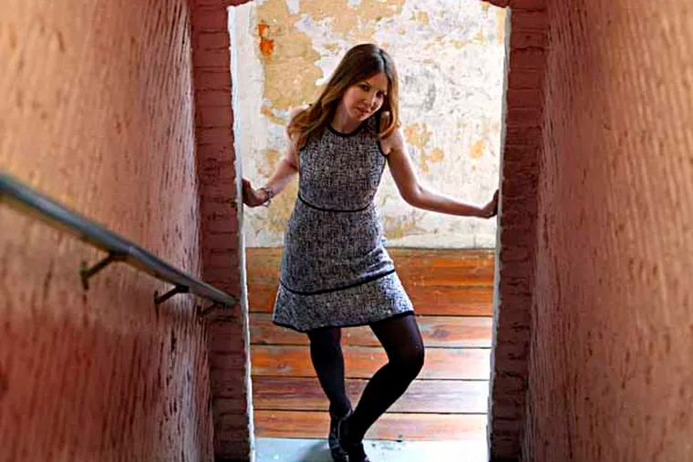 Fashion designer Paula Hian photographed in a stairway at her studio in Philadelphia on May 14, 2013. ( DAVID MAIALETTI / Staff Photographer )