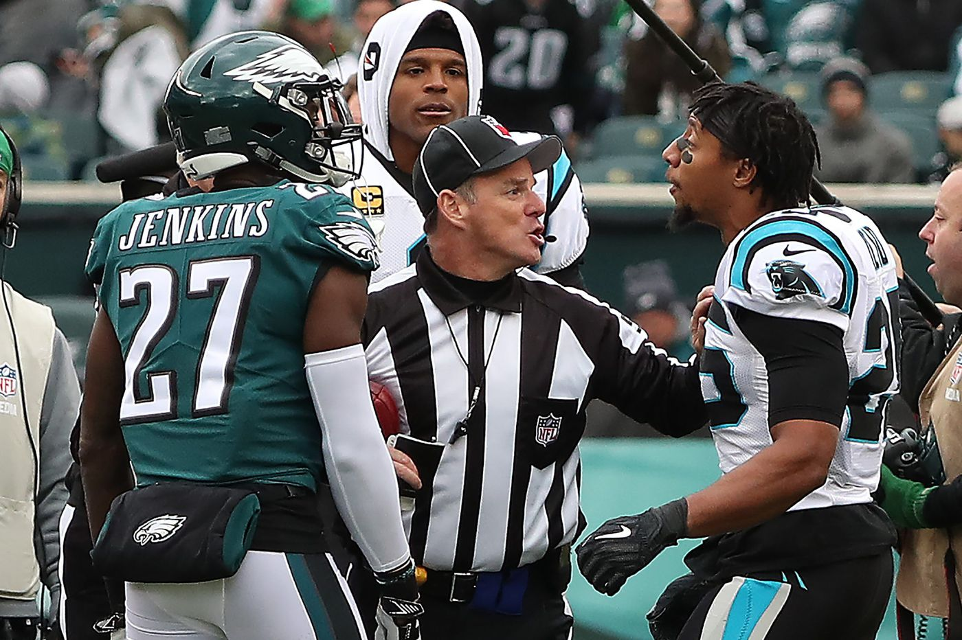 Panthers' Eric Reid exchanges words with Eagles' Malcolm Jenkins prior to game, delivers late hit on Carson Wentz