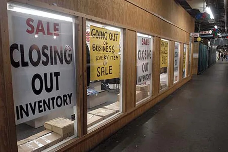 File photo showing going out of business signs at a store.