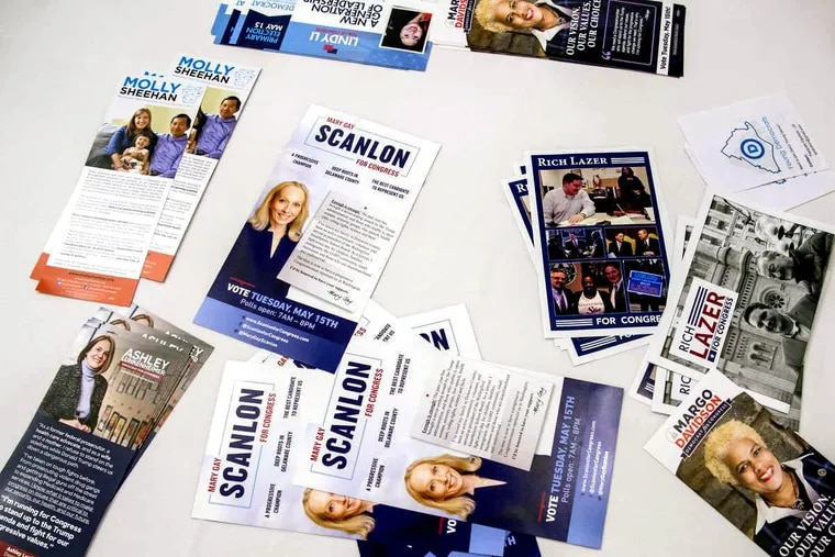 Campaign brochures for candidates in the Democratic primary in the Fifth Congressional District are spread on a table during their debate April 26, 2018 at Galdo's Catering in South Philly. (Molly Sheehan, Rich Lazer, Ashley Lukenheimer, Lindy Li, Mary Gay Scanlon, and Margo Davidson are the names visible).