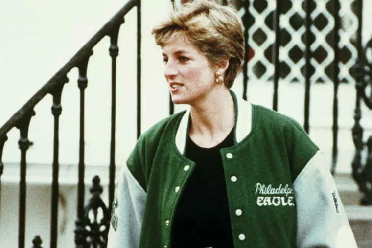 The Princess of Wales wears a Philadelphia Eagles football jacket as she leaves Wetherby Preparatory, an elementary school in London, Jan. 10, 1991, after bringing six-year-old Prince Harry back from the Christmas break. (AP Photo/Press Association/Michael Stephens)