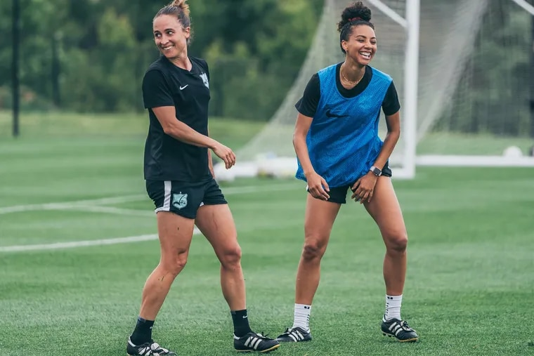 Sky Blue FC's Gina Lewandowski (left), a Bethlehem native and Lehigh product, with Estelle Johnson (right) at a recent practice session.