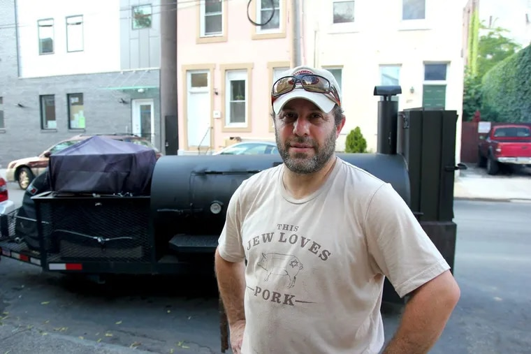 Michael Strauss of Mike's BBQ at his smoker outside El Bar on July 7.