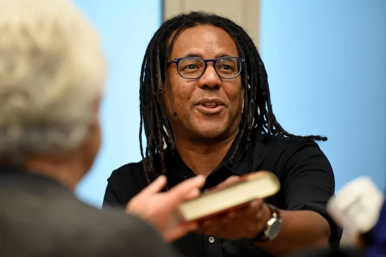 """Colson Whitehead autographs copies of """"The Underground Railroad"""" during a 2018 event in Ardmore."""