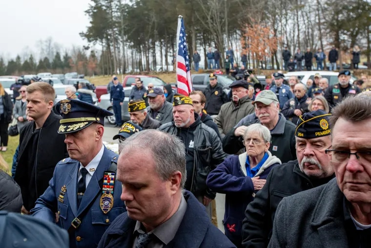 A crowd of people stands at a funeral for Vietnam War Veteran, Peter Turnpu, who was buried with military honors at Brigadier General William C. Doyle Memorial Cemetery in Wrightstown NJ January 18, 2019. Turnpu had no traceable family to host the funeral when he died of natural causes on December 9, 2018.