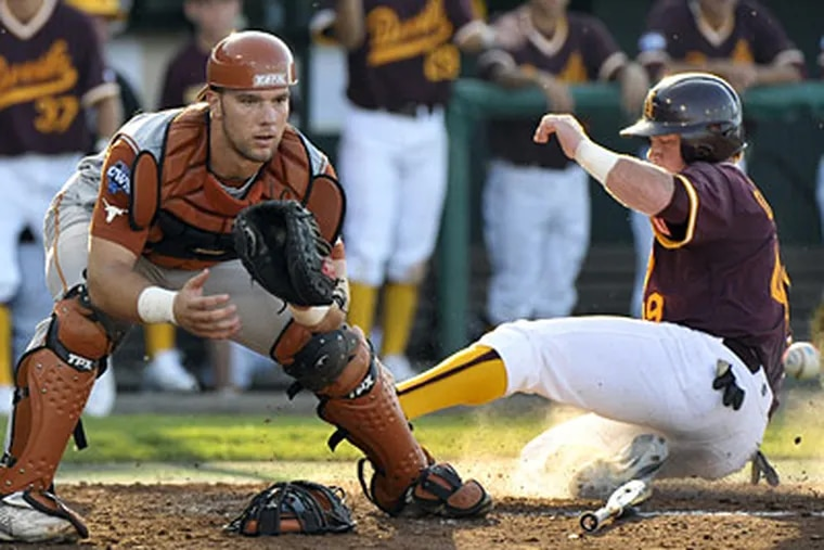 Texas catcher Cameron Rupp, left, was selected in the third round of the baseball draft by the Phillies. (AP Photo/Ted Kirk)