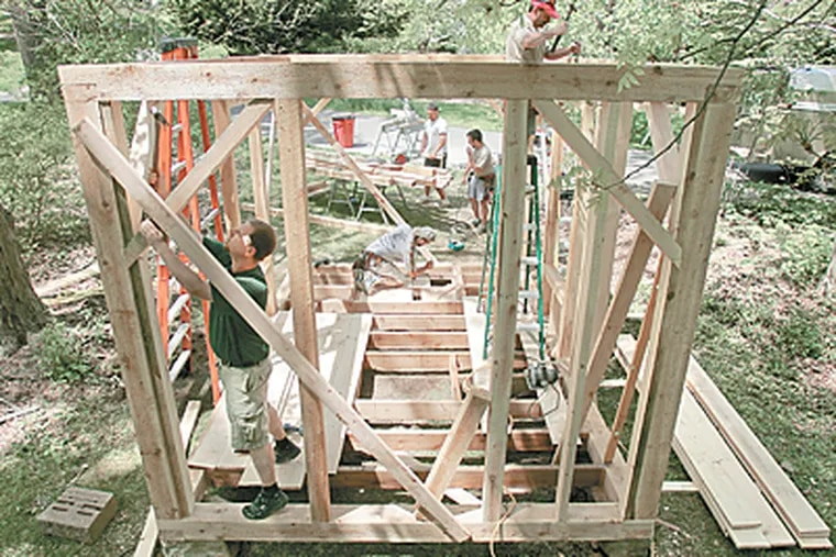 Carpenters from Pine Street Carpenters of West Chester build a replica of Thoreau's Walden Pond cabin at Tyler Arboretum in Media. (Barbara L. Johnston / Inquirer)