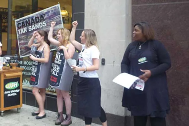 Katelaine Frandsen (left), Olivia Kiernan, Lauren Andrews and Brianna Crumbley, protest on the 1400 block of Walnut Street.