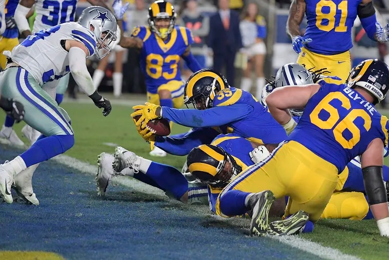Los Angeles Rams running back C.J. Anderson (35) scores a second-quarter touchdown in front of Dallas Cowboys safety Jeff Heath (38) during the NFL Divisional Round at the Los Angeles Memorial Coliseum on Saturday, Jan. 12, 2019. (Max Faulkner/Fort Worth Star-Telegram/TNS)