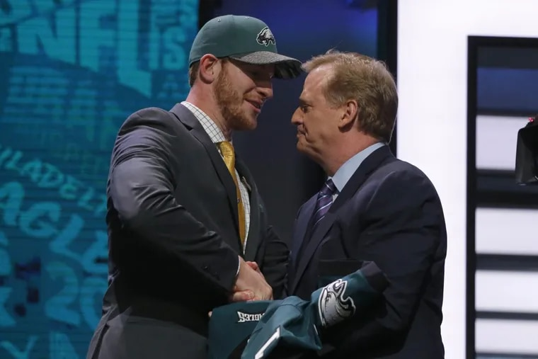 Carson Wentz shakes hands with NFL commissioner Roger Goodell after being taken by the Eagles with the second pick in the 2016 Draft. Moments earlier, the Rams had selected Jared Goff. (AP Photo/Charles Rex Arbogast)