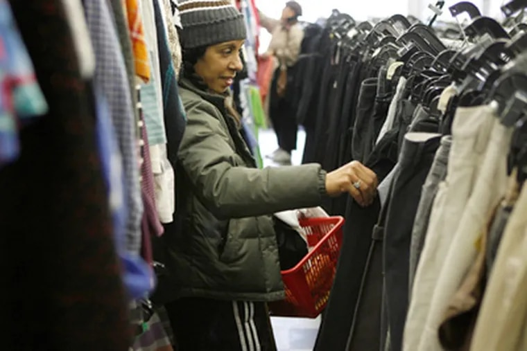 Michelle Dejean shops last week at a Salvation Army in New York. By necessity - and out of fear that economic conditions could get even worse and stay that way for a while - thriftiness is making a comeback in America. (AP Photo/Seth Wenig)