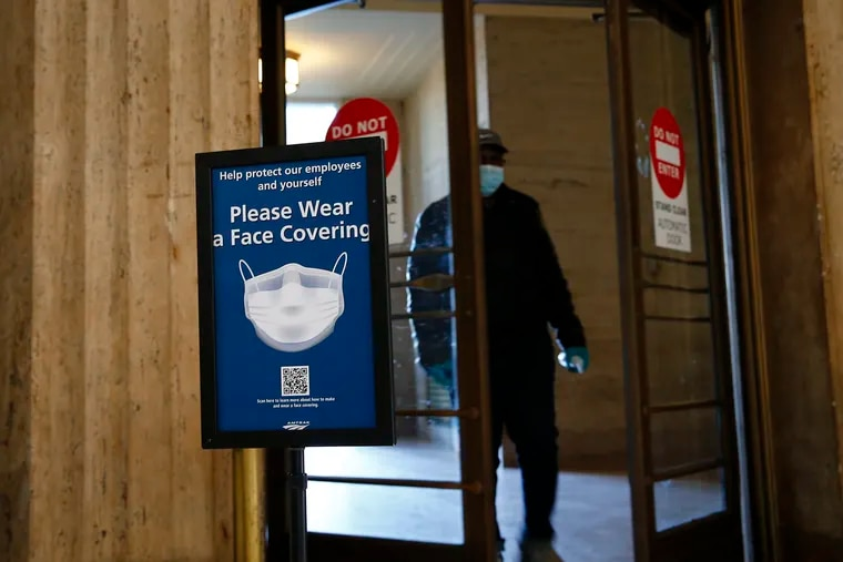 Signs at 30th Street Station ask visitors to wear face mask. Amtrak now says it will ban customers who don't comply with the requirement.
