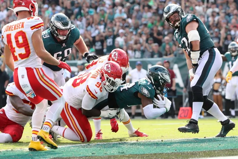 Philadelphia Eagles running back Kenneth Gainwell (14) goes up the middle for 7 yards to score during the fourth quarter against the Kansas City Chiefs Sunday, October 3, 2021 at Lincoln Financial Field in Philadelphia.