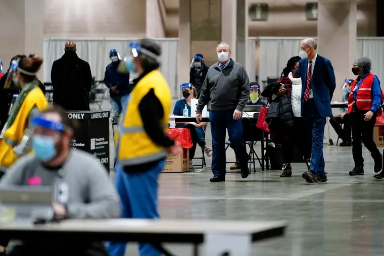 Mayor Jim Kenney (center) and Health Commissioner Thomas Farley (second from right) visit the city's COVID-19 vaccination site at the Pennsylvania Convention Center in early February. The city is in talks with FEMA over a federally managed mass vaccination clinic at the site.