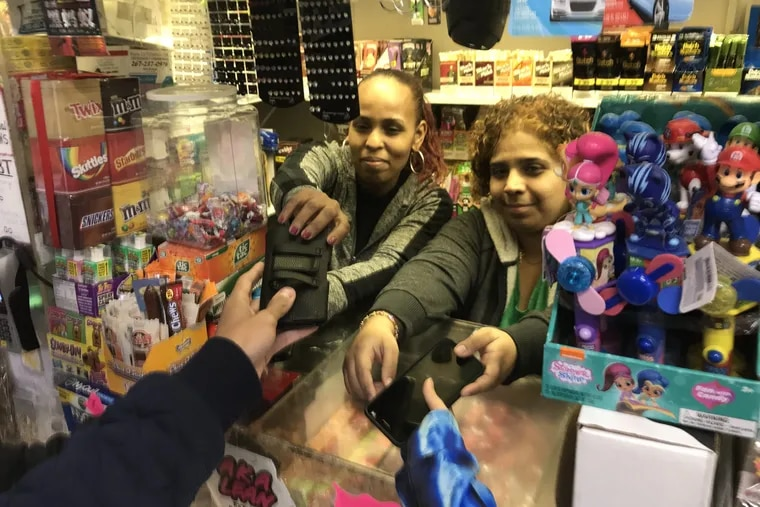 Sisters Lizbeth Vazquez and Luz Morales at Nelvin Grocery.