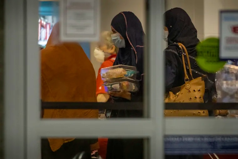 The first of the Afghan evacuees arrive at Philadelphia International Airport on Saturday morning, passing through Terminal A-East.