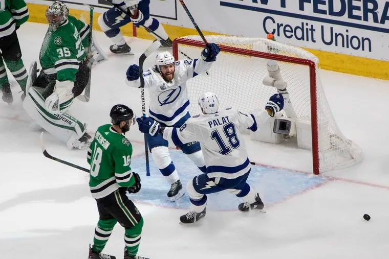 Tampa Bay Lightning center Brayden Point (21) celebrated his goal with teammate Ondrej Palat, right, as Dallas Stars goaltender Anton Khudobin (35) and center Jason Dickinson, front left, reacted during Game 3 of the Stanley Cup Final on Wednesday night.