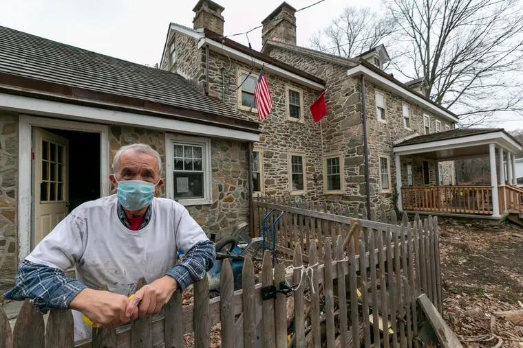 Former Shipley School humanities teacher Tony Morinelli is spending his retirement renovating Harford Hall, a mill and residence from the 18th century in Haverford Township. He's standing outside of the well house.