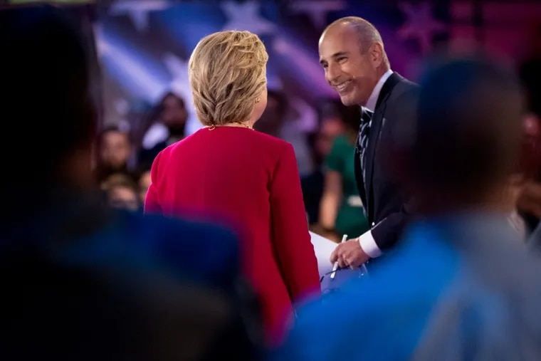 """Hillary Clinton takes the stage with """"Today"""" show co-anchor Matt Lauer at the NBC """"Commander-In-Chief Forum"""" on the Intrepid carrier parked off Manhattan in September 2016."""