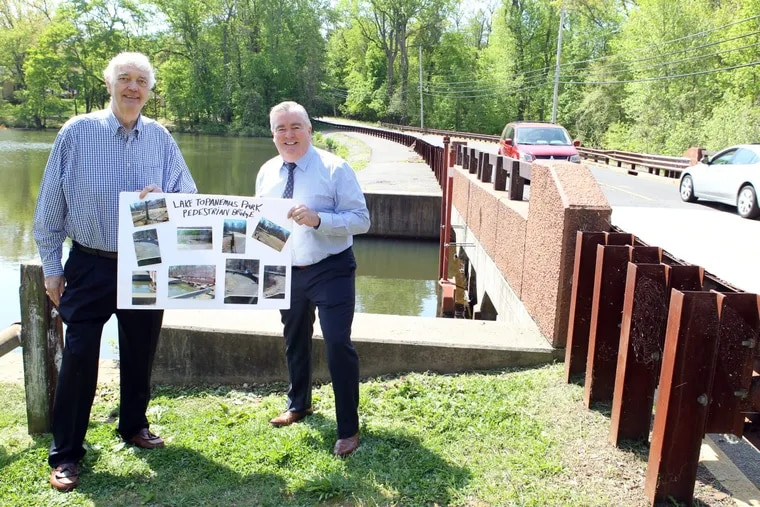 BUDGETS13P.(L-R) Freehold Borough Councilmen Ron Griffiths and Kevin Kane at the site of the proposed pedestrian bridge over Lake Topanemus, Freehold, NJ. Citizens voted to fund the building of the bridge through the process of participatory budgeting.