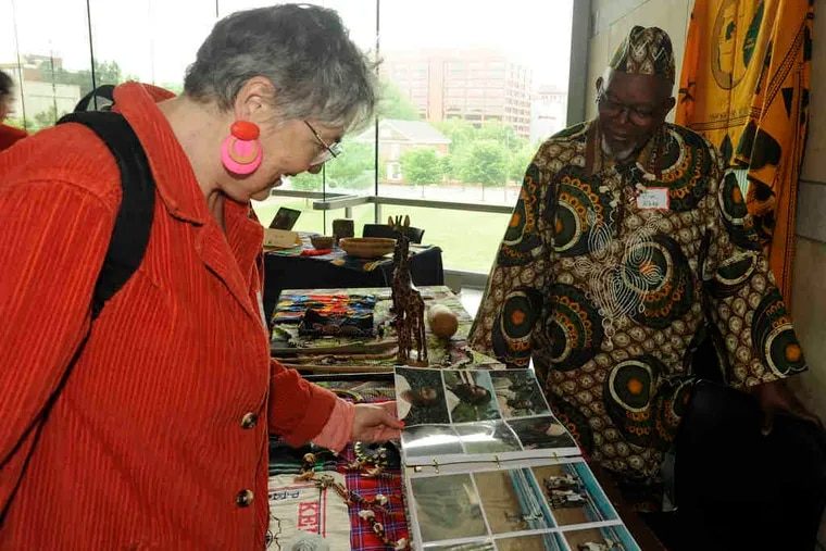 who worked in Kenya with the Corps, shares photographs with Maurine Dooley, who served in Cameroon.