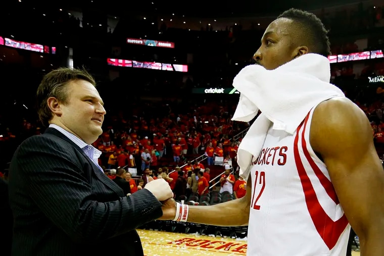 Dwight Howard (right), then with the Houston Rockets, celebrates with then-general manager Daryl Morey, now with the Sixers, in 2015. They are back together.
