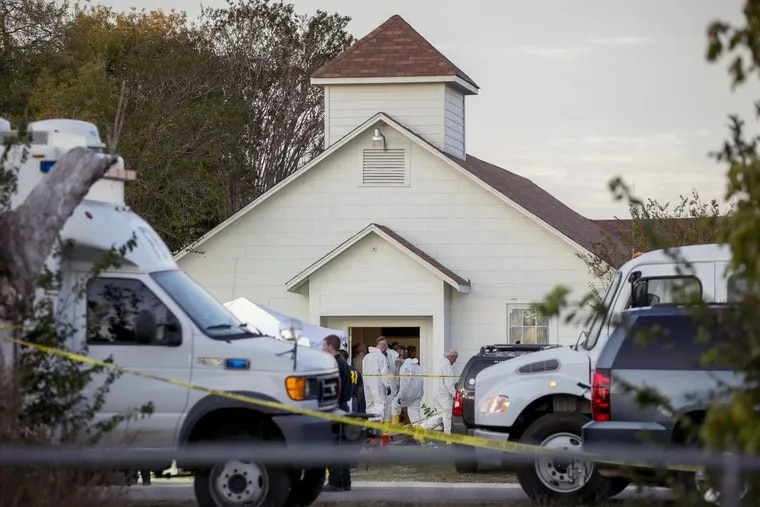 Investigators work at the scene of a deadly shooting at the First Baptist Church in Sutherland Springs, Texas in November 2017. A Defense Department failure allowed a disgraced former Air Force member to buy a high-powered rifle and shoot 26 people to death at the church.