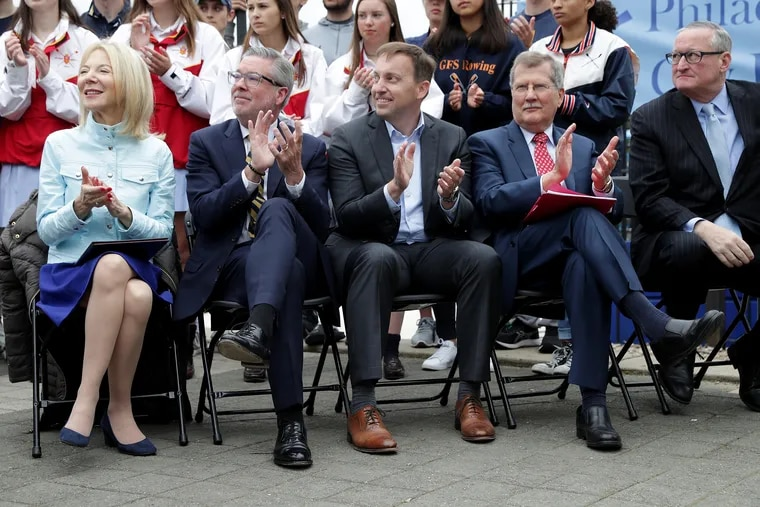 Left to right: Amy Gutmann, president of the University of Pennsylvania; John Anderson Fry, president of Drexel University; Mark C. Reed, president of Saint Joseph's University; Richard M. Englert, president of Temple University; and Mayor Jim Kenney attend an event to announce the Schuylkill River Dredge Project.