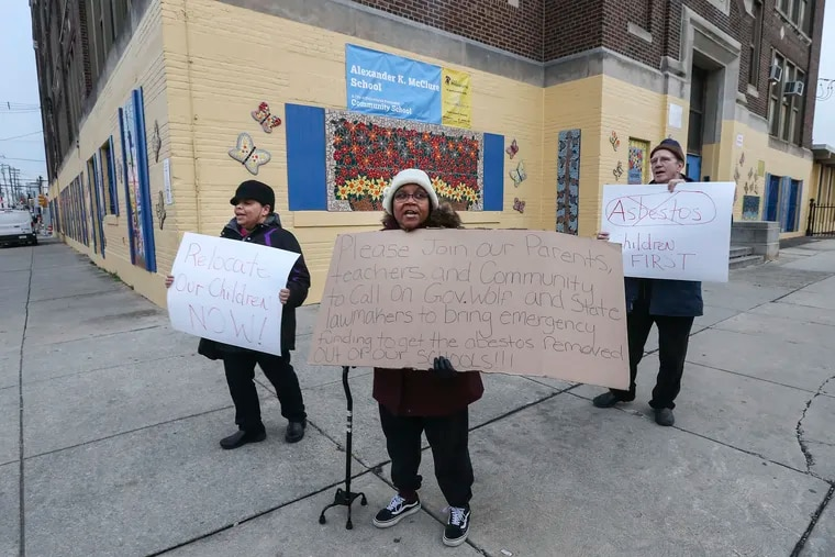 Grandmother/parents Rosalind Lopez, left, and Veronica Bing-Perry, center, join with neighbor Chris Hoeppner to  protest asbestos at McClure elementary, 6th and Hunting Park, on Thursday,  Jan. 23, 2020.