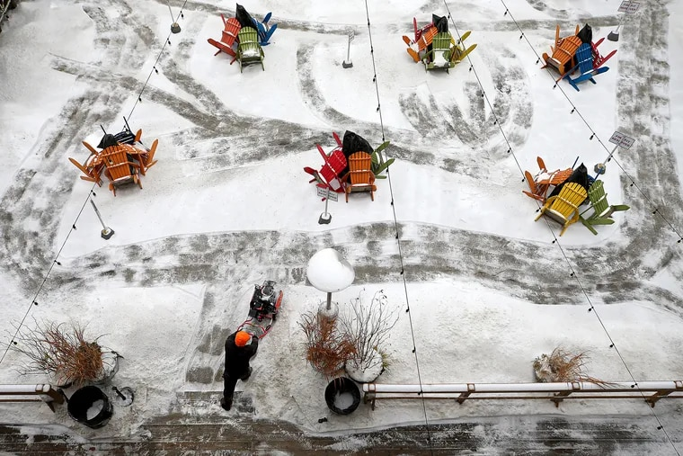 Delaware Waterfront Corporation employee Curtis Gilyard uses a snow blower to clear a path at the Blue Cross Riverrink Winterfest in Philadelphia.