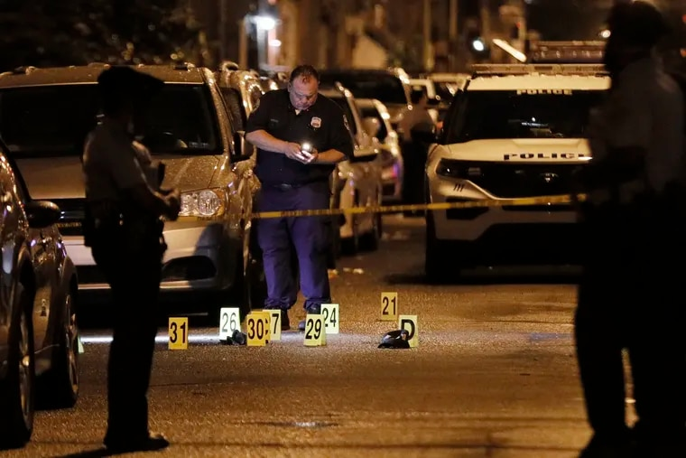 Philadelphia police process evidence at South Cleveland Street and Moore Street in Philadelphia after four people were shot just after 8 pm on Sept. 2, 2020.  Two teenagers died.