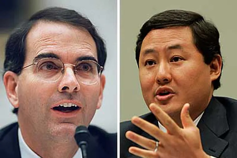 Former Justice Department officials Jay Bybee (left) and John Yoo are accused of authorizing torture. (AP Photos)