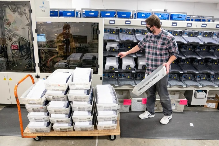 A worker sorts Chester County mail ballots last year.