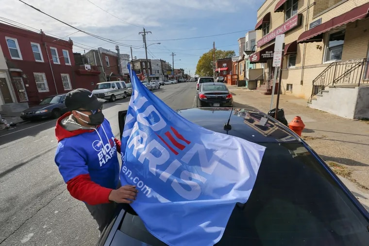 A Biden campaign volunteer in the Hunting Park section of Philadelphia on Election Day. Hunting Park is one of several predominantly Latino and Black areas of the city where Joe Biden won by smaller margins than Hillary Clinton.