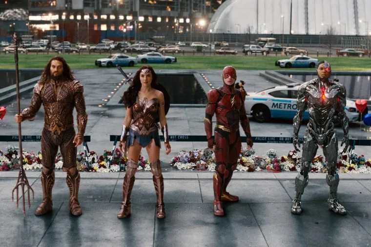 """This image released by Warner Bros. Pictures shows Jason Momoa, from left, Gal Gadot, Ezra Miller and Ray Fisher in a scene from """"Justice League."""""""