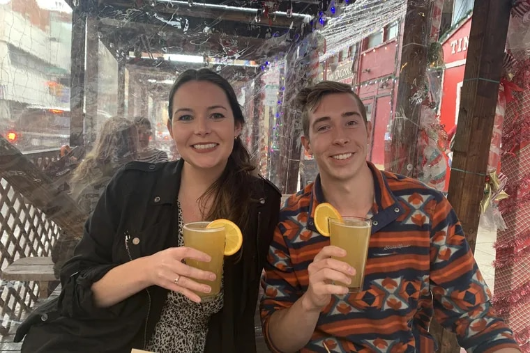 Jelena Loncar, left, with her brother Milan Loncar, seen in a December 2020 photo outside of Tinsel bar in Center City Philadelphia.