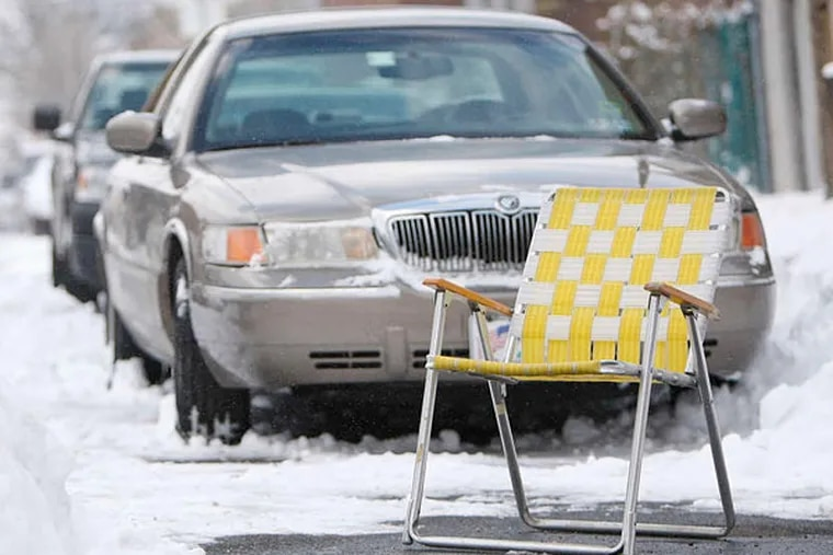 Common sight after snowfall: Lawn-chair dibs on a cleared-out parking spot. (David Maialetti/Staff Photographer)