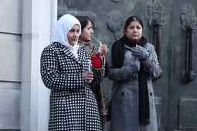 Relatives of Briton Akmal Shaikh conducting a vigil yesterday outside the Chinese Embassy in London.