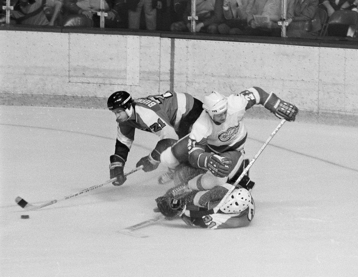 b6cf3244a Mike Businak (left) takes control of the puck as the Detroit Red Wings