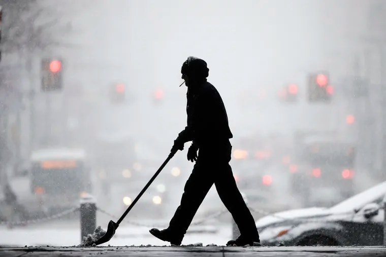 A worker at City Hall shovels snow during a winter storm in Philadelphia, Wednesday, Feb. 20, 2019. The seasonal differences that define life in the Northeast U.S. are beginning to blur under climate change, writes the Franklin Institute's Rachel Valletta.