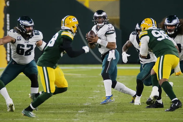 Eagles quarterback Jalen Hurts (2) looks to throw in the third quarter of a game against the Green Bay Packers at Lambeau Field in Green Bay, Wis., on Sunday, Dec. 6, 2020.