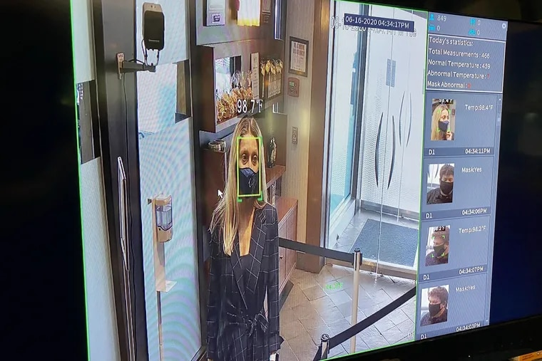 Rosita Lamberti is seen in a video monitor at Caffe Aldo Lamberti, her family's restaurant in Cherry Hill. Her body temperature, taken y a thermal camera, is shown. The restaurant red-flags body temperatures over 99.5 degrees.