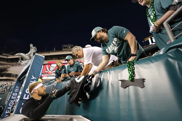 Eagles tight end Zach Ertz sign his autograph for fans before the Eagles play the Tampa Bay Buccaneers on Thursday, October 14, 2021 in Philadelphia.
