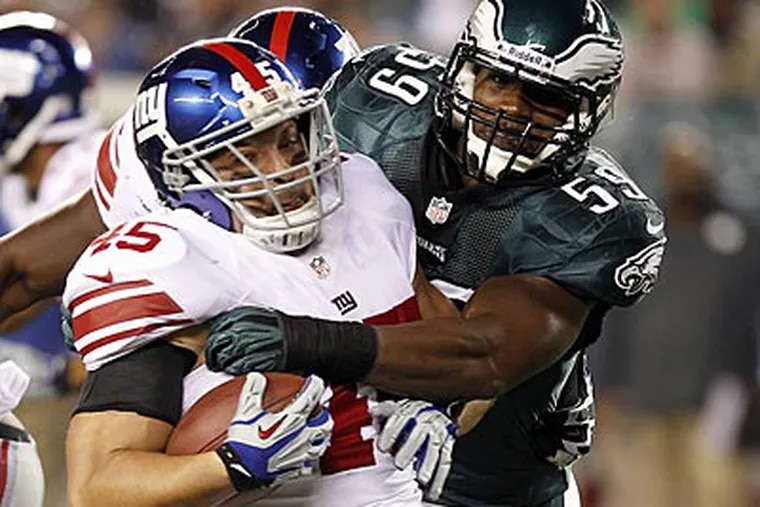 """""""He's our quarterback on defense,"""" Mychal Kendricks said of Demeco Ryans. """"He brings the guys together."""" (Yong Kim/Staff Photographer)"""